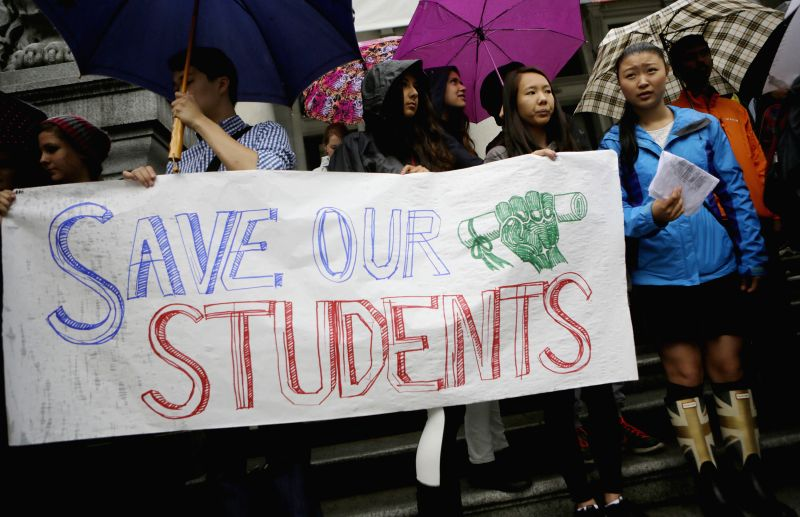 VANCOUVER (CANADA), Sept. 3, 2014 Students protest with banners against the education dispute between the teachers and government outside Vancouver Art Gallery in Vancouver, Canada, Sept.