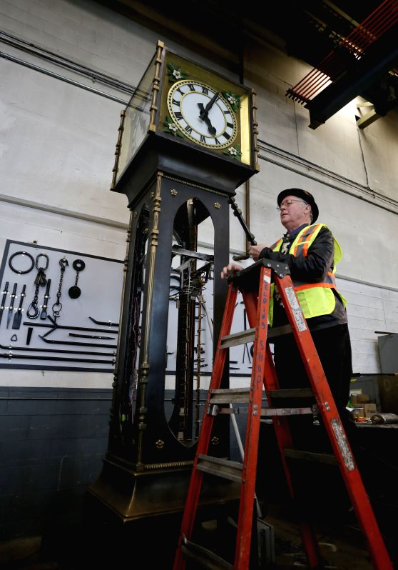 Clockmaker Ray Saunders returns a copper decorations onto the Gastown steam clock at an workshop in Vancouver,  Canada, Nov. 19,  2014. The Vancouver's iconic Gastown steam clock is ...