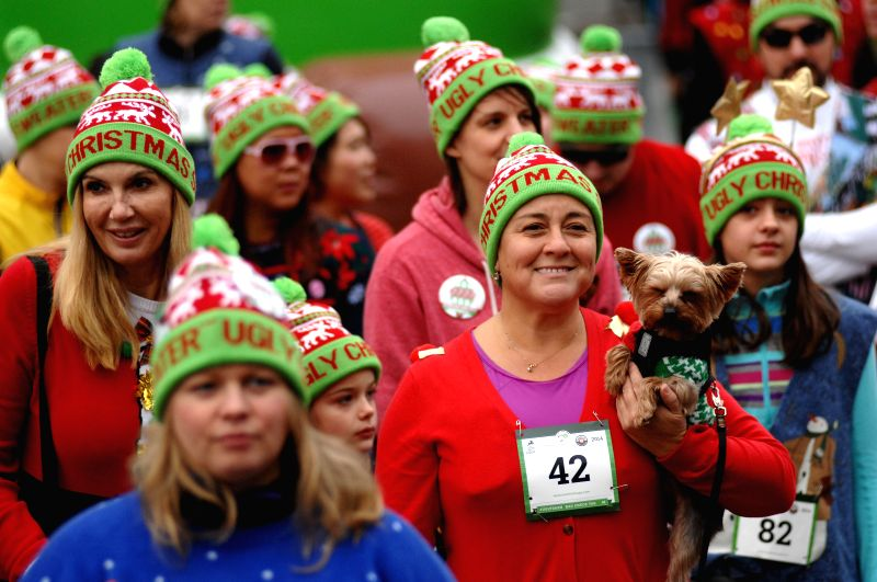 Runners and walkers participate in the Ugly Sweater Run 5K in Vancouver, Canada, Dec.13, 2014. Thousands of people around the world took part in the annual ...