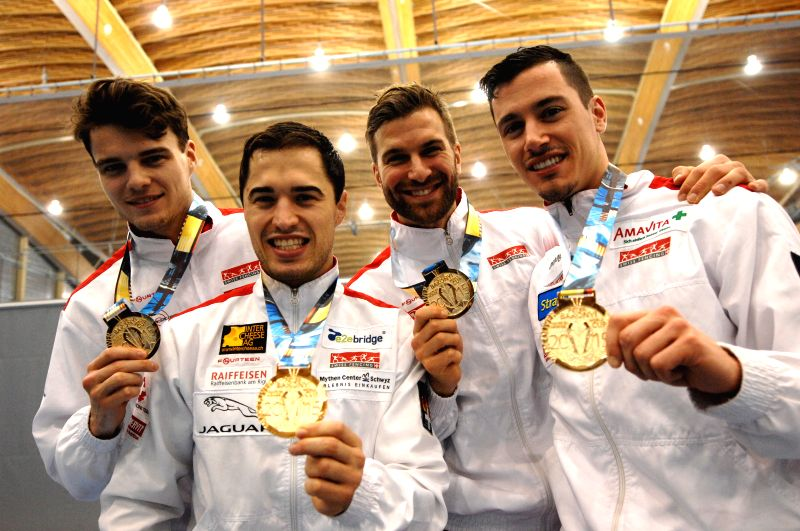 Swiss fencers (L to R) Peer Borsky, Max Heinzer, Fabian Kauter and Benjamin Steffen pose with their gold medals after defeating Team Ukraine in the finals of 2015