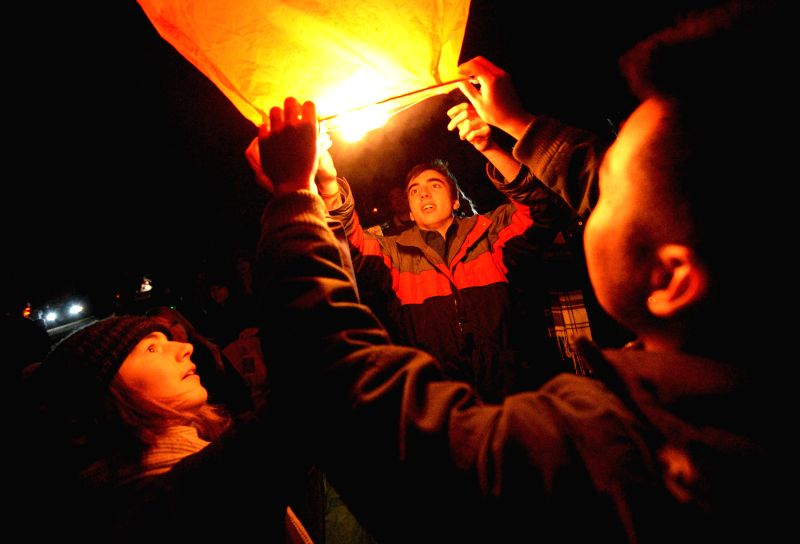 People launch a lantern during a celebration of Chinese Lunar New Year, in Vancouver, Canada, on Feb. 21, 2015. Several hundreds of lanterns were released in the ...