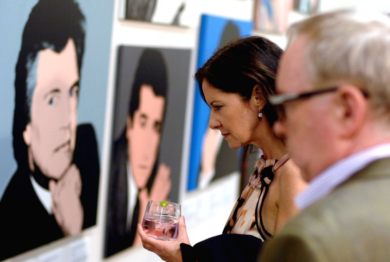 "Visitors attend the opening of the exhibition ""WarholA Different Idea of Love"" in Yaletown warehouse in Vancouver, Canada, Feb. 27, 2015. The ..."