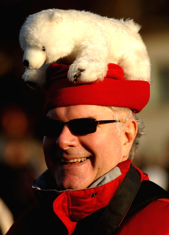 A man wearing a funny hat takes part in the 95th annual Polar Bear Dip event 2015 in Vancouver, Canada, Jan. 1, 2015. The Vancouver Polar Bear Dip event celebrated