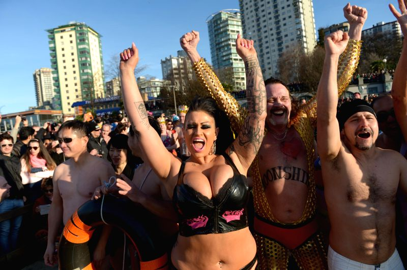 People take part in the 95th annual Polar Bear Dip event 2015 in Vancouver, Canada, Jan. 1, 2015. The Vancouver Polar Bear Dip event celebrated its 95th ...