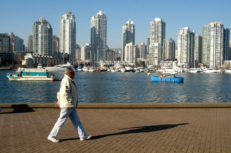 A man walks in False Creek area in Vancouver, Canada, on Jan. 20, 2015. Vancouver has been ranked as the secound most unaffordable house market in the world, ...