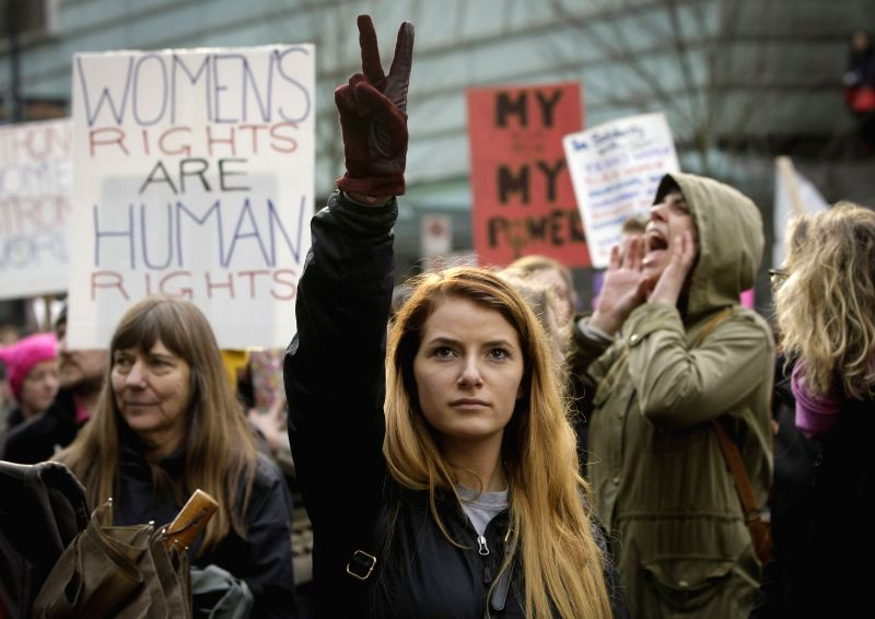 VANCOUVER, Jan. 22, 2017 - People attend the Women's March to protest against U.S. President Donald Trump's humiliation of women in downtown Vancouver, Canada, Jan. 21, 2017. Rallies of this kind ...