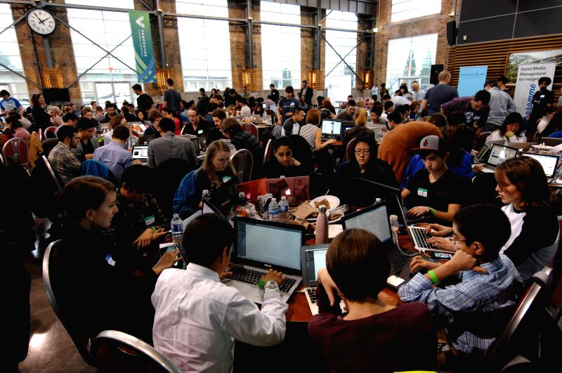 People learn how to code during the 2nd annual HTML500 free coding camp in Vancouver, Canada, Jan.24, 2015. The HTML500 is a one-day event where Canada's top 50 ..