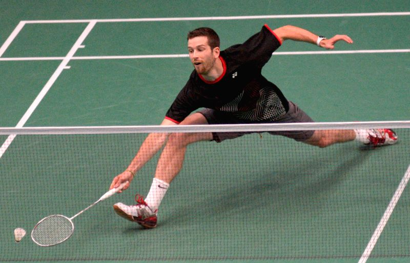 Kyle Golding of Canada hits a return to his compatriot Martin Guiffre at the Yonex Canada Open GrandPrix 2014 badminton tournament in Vancouver, Canada, June 30, ..