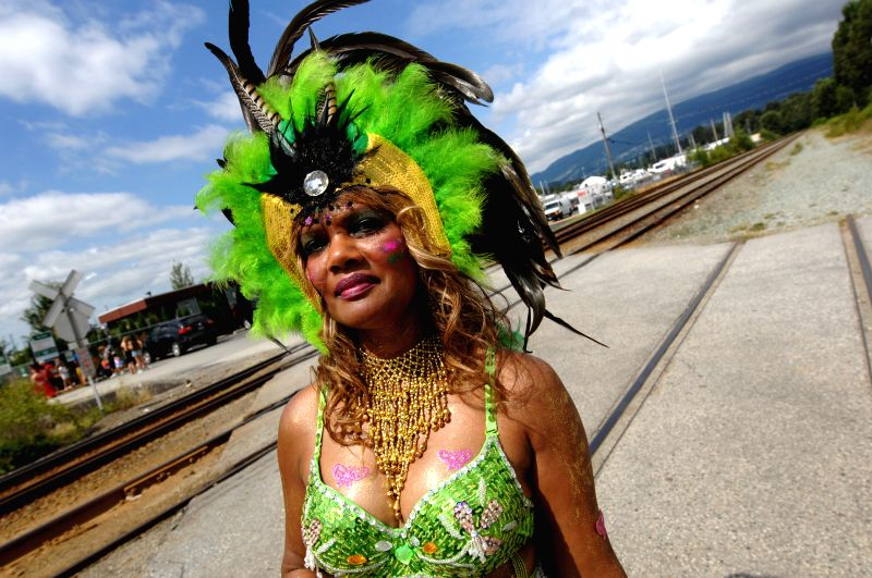 A woman takes part in the annual Multicultural Caribbean Street Parade in north Vancouver, BC, Canada, July 26, 2014.