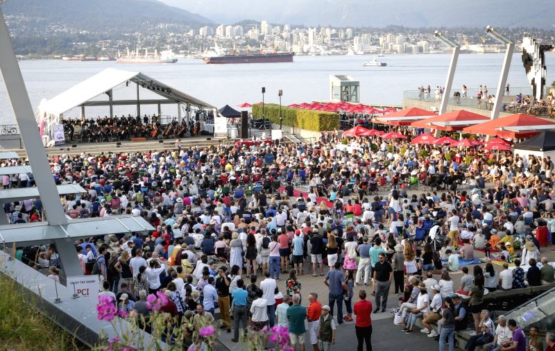 VANCOUVER, July 27, 2018 - Musicians play music on stage during a free outdoor concert performed by Vancouver Metropolitan Orchestra at Jack Poole Plaza in Vancouver, Canada, July 26, 2018. Thousands ...