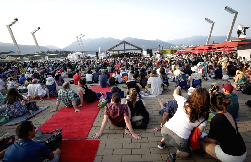 VANCOUVER, July 27, 2018 - People enjoy a free outdoor concert performed by Vancouver Metropolitan Orchestra at Jack Poole Plaza in Vancouver, Canada, July 26, 2018. Thousands showed up at Jack Poole ...