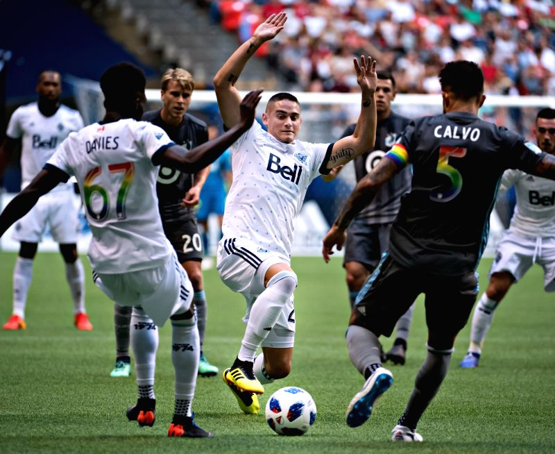 VANCOUVER, July 29, 2018 - Vancouver Whitecaps' Jakob Nerwinski (C) vies with Minnesota United's Francisco Calvo (2nd R) during the MLS regular season soccer match between Vancouver Whitecaps and ...