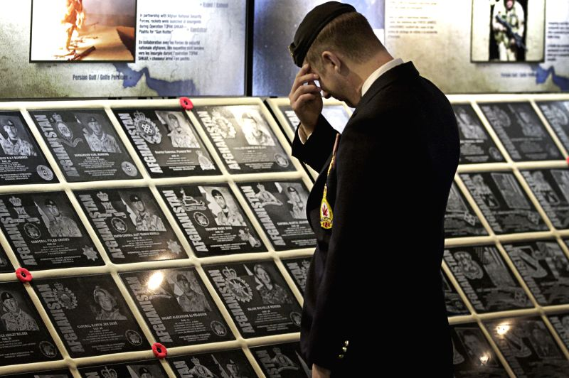 A soldier attends the Afghanistan Memorial Vigil Commemoration Ceremony at Vancouver Convention Centre in Vancouver, Canada, July 29, 2014. The Afghanistan ...