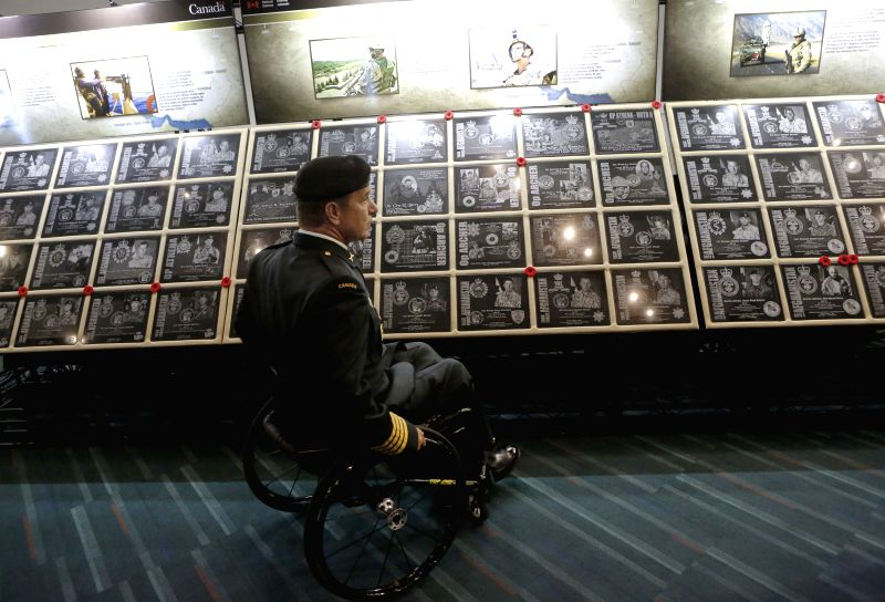 A veteran attends the Afghanistan Memorial Vigil Commemoration Ceremony at Vancouver Convention Centre in Vancouver, Canada, July 29, 2014. The Afghanistan ...