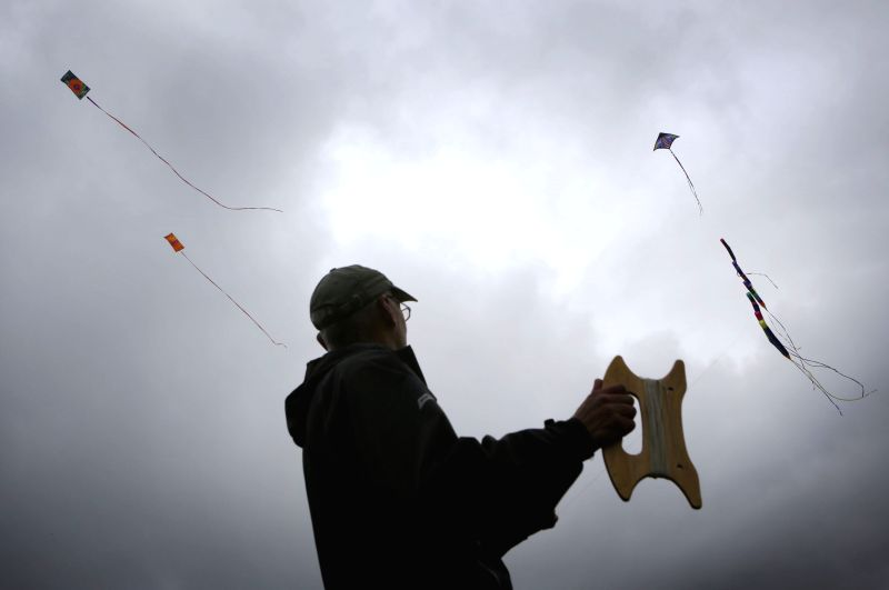 A man flies a kite at the 39th Pacific Rim kite festival in Vancouver, Canada, June 15, 2014. Dozens of kite enthusiasts participate in the 39th annual Pacific ...