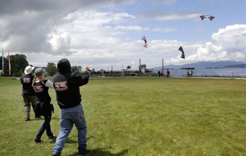 Kite enthusiasts control kites flying at the 39th Pacific Rim kite festival in Vancouver, Canada, June 15, 2014. Dozens of kite enthusiasts participate in the ...