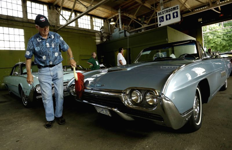 A collector cleans his car at the Collector Car Show in Vancouver, Canada, June 20, 2014. The second annual Collector Car Show and Auction showcases over 700 ...