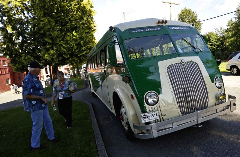 Visitors look at an vintage bus built in 1937 at the Collector Car Show in Vancouver, Canada, June 20, 2014. The second annual Collector Car Show and Auction ...