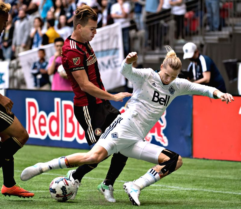 VANCOUVER, June 4, 2017 - Atlanta United FC's Leandro Gonzalez Pirez (L) and Vancouver Whitecap Brek Shea compete for the ball during the regular season action at BC Place Stadium, Vancouver, Canada ...