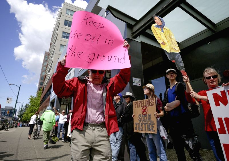 VANCOUVER, June 4, 2018 - People participate in a protest against the Trans Mountain pipeline expansion project in Vancouver, Canada, on June 4, 2018. The Canadian government announced on May 29 that ...