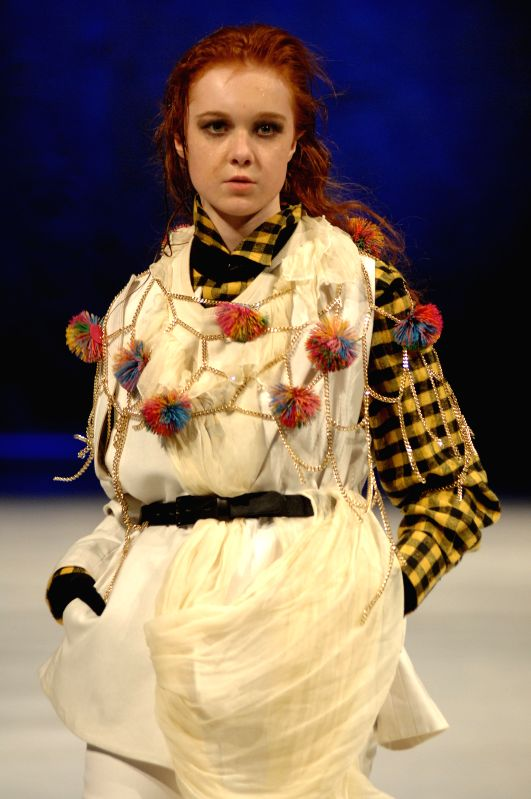 A model shows the latest creations by popular South Korean designer Ha Sang Beg at the closing day of Vancouver Fashion Week Fall/Winter 2015, in Vancouver, ...