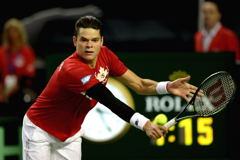 Canada's Milos Raonic returns a ball against Japan's Tatsuma Ito during the match at Davis Cup tennis tournament in Vancouver, Canada, March 6, 2015. Raonic ...