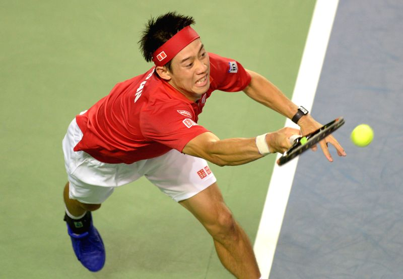 Japan's Kei Nishikori returns a ball against Canada's Vasek Pospisil during thier match at Davis Cup tennis tournament in Vancouver, Canada, March 6, 2015. ...