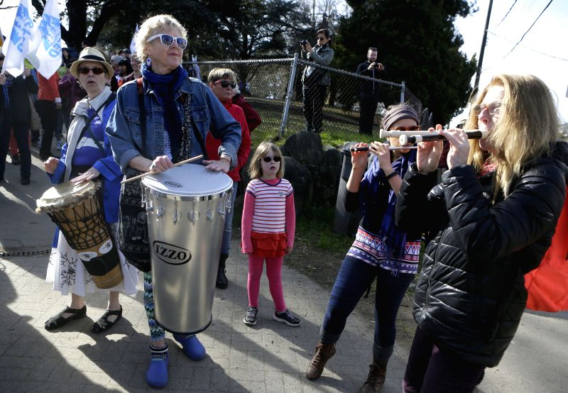 Participants play music during the parade marking the International Women's Day in Vancouver, Canada, on March 8, 2015. Around 200 women participated in the ...