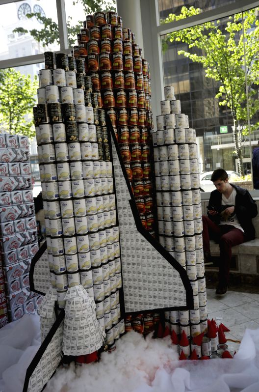 """A space shuttle-shaped canned food sculpture is seen during the """"Canstruction"""" competition in Vancouver, Canada, May 11, 2014. The Vancouver region's ..."""