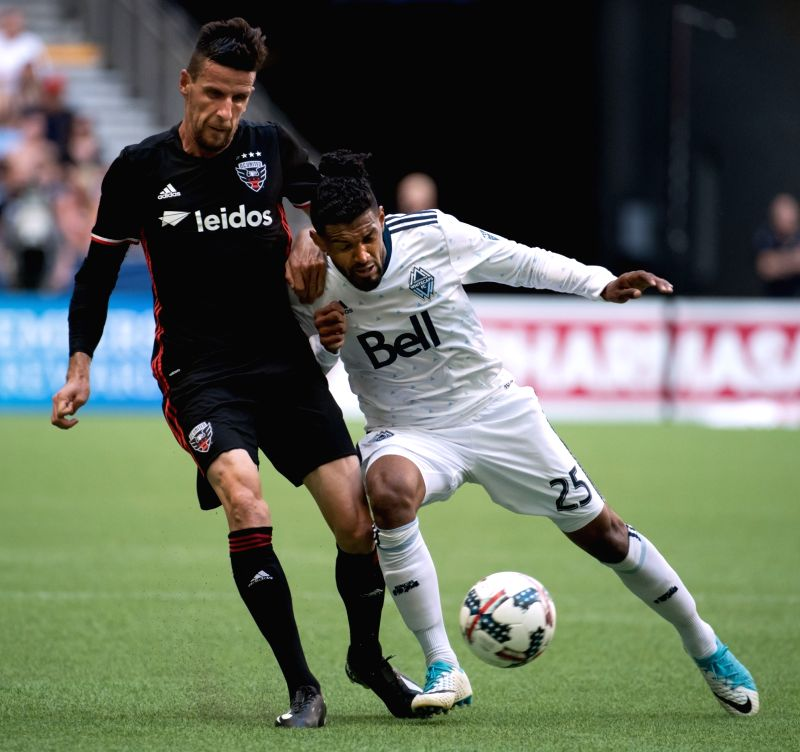 VANCOUVER, May 28, 2017 - Sheanon Williams(R) of Vancouver Whitecaps FC vies with Sebastien Le Toux of D.C. United during the 2017 Major League Soccer (MLS) match between Vancouver Whitecaps FC and ...