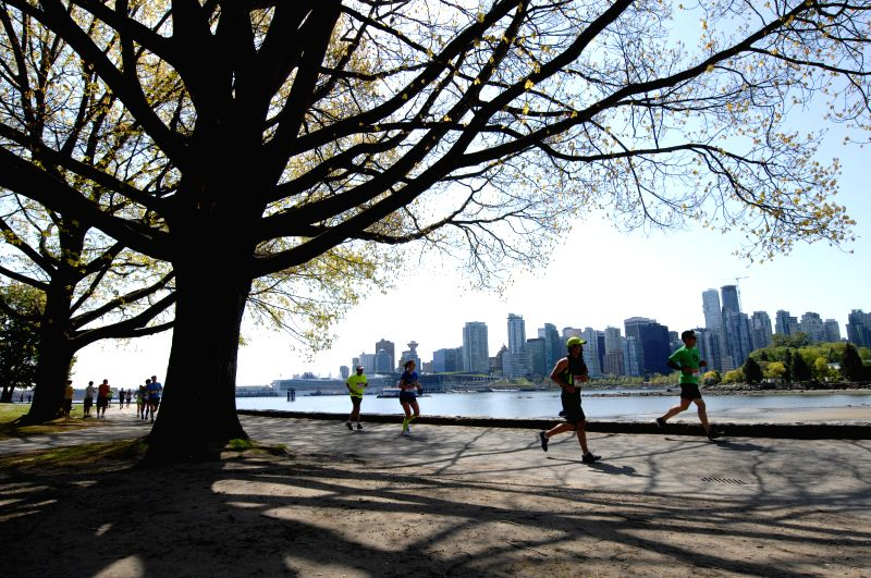 Runners take part in the 44th annual BMO Vancouver Marathon in Vancouver, Canada, May 3, 2015. Some 16,000 people from nearly 50 countries and regions attended the ...