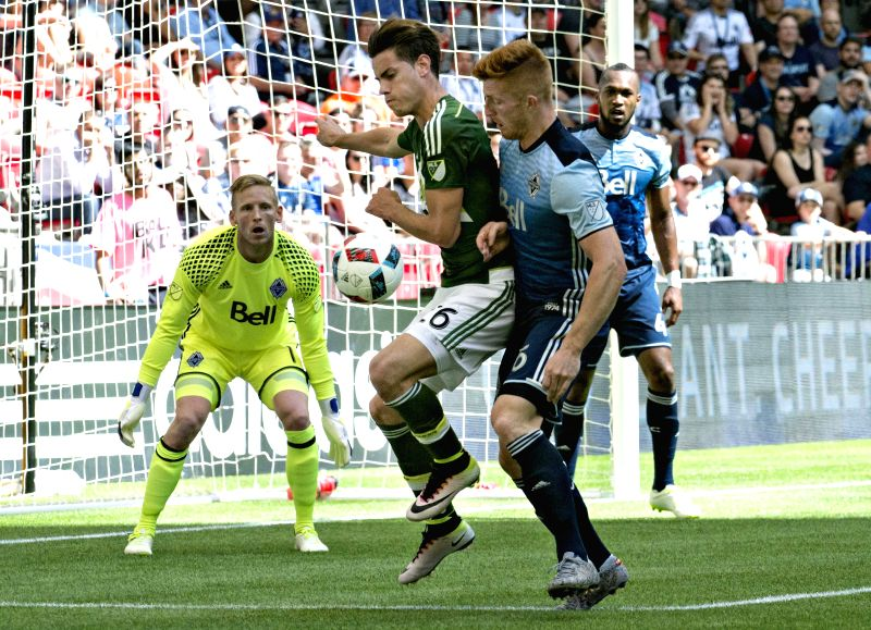 VANCOUVER, May 8, 2016 - Portland Timbers' Lucas Melano (front L) vies with Vancouver Whitecaps' Tim Parker (front R) during their MLS match in Vacouver, Canada, May 7, 2016. The Vancouver Whitecaps ...