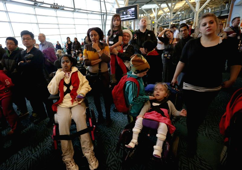 Sick kids wait for boarding inside the airport terminal during the North Pole visit event at Vancouver International Airport in Vancouver, Canada, Dec. 10, 2014. About 100 sick kids are ...