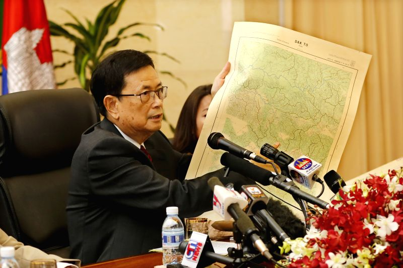 Var Kimhong, Cambodian senior minister in charge of border affairs, shows a map during a press conference on Cambodia-Vietnam border issues in Phnom Penh, ...