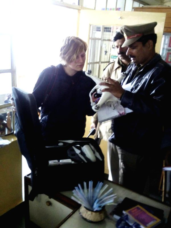 A policeman inspects a drone that was allegedly being operated by two Russian women in Varanasi on Jan 12, 2015.