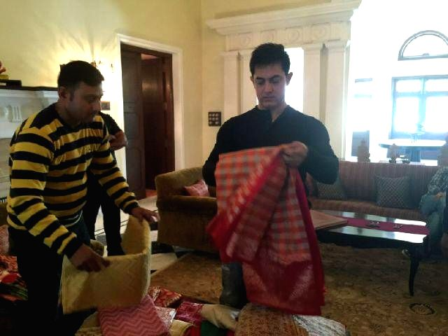 Actor Aamir Khan buys Banarasi saree for actress Anushka Sharma at a  store in Varanasi, on Dec 8, 2014.