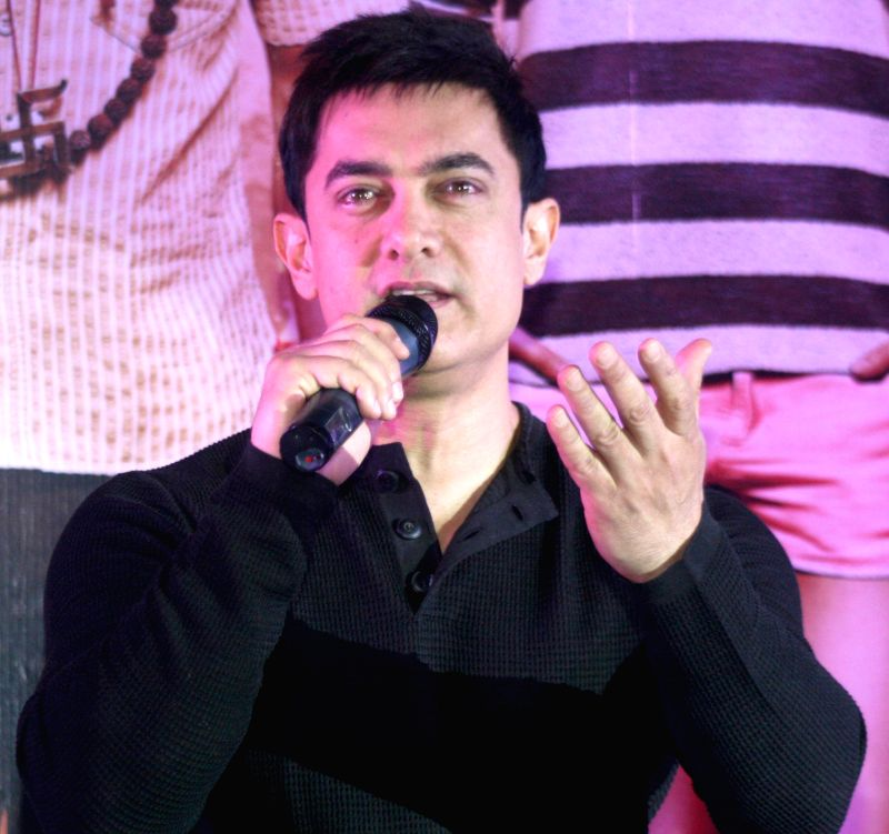 """Actor Aamir Khan during a press conference to promote his upcoming film """"PK"""" in Varanasi on Dec 7, 2014."""