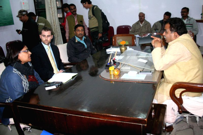 An American delegation calls on Varanasi Mayor Ram Gopal Mohale to discuss about pollution free Ganga in Varanasi, on Dec 11, 2014.
