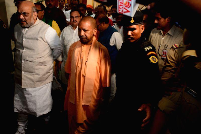 Varanasi: BJP chief Amit Shah and Uttar Pradesh Chief Minister Yogi Adityanath review the preparations ahead of Prime Minister Narendra Modi's filing of nomination on April 26, in Varanasi on April 12, 2019. A day before filing nomination, the Prime