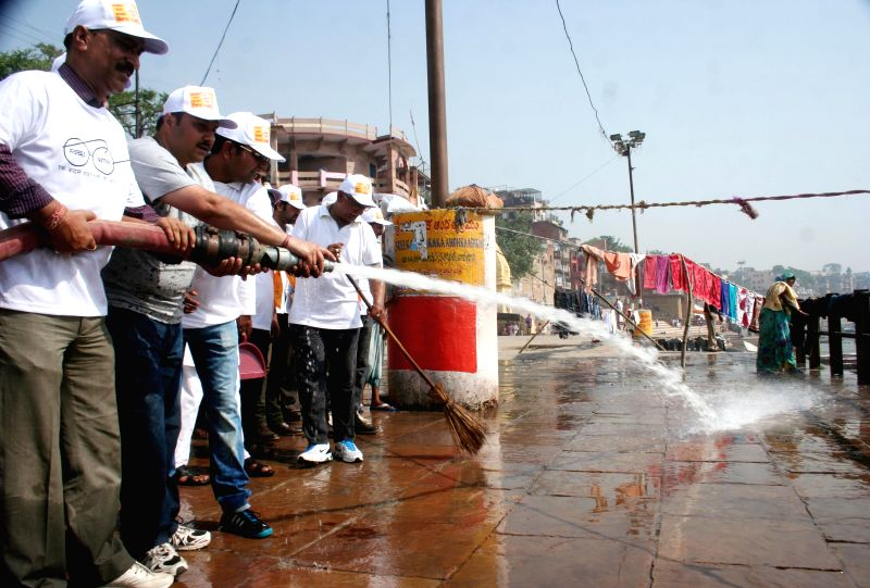 BJP workers busy cleaning Ganga Ghats in Varanasi, on May 3, 2015.