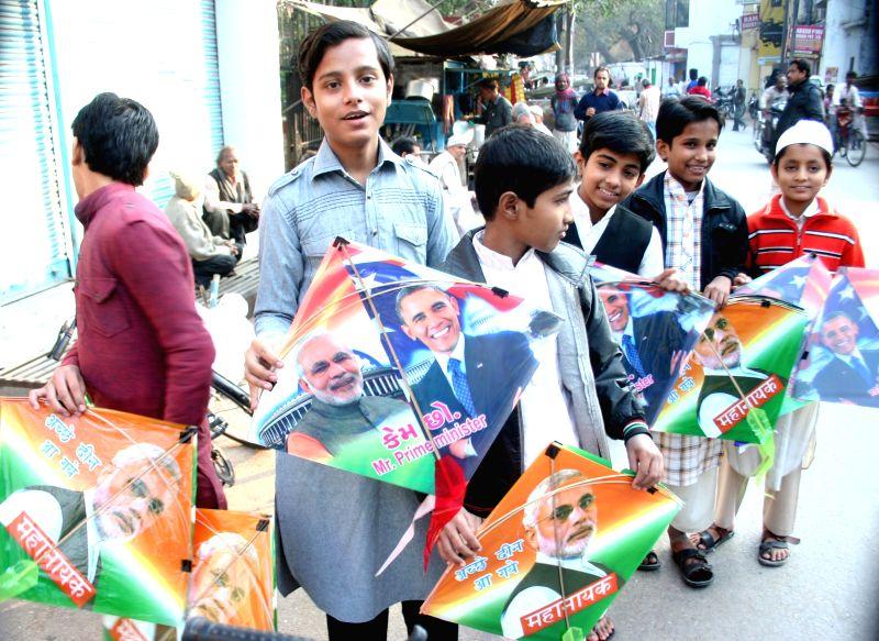 Children with kites printed with photo of Prime Minister Narendra Modi and US President Barack Obama in Varanasi on Dec. 13, 2014. - Narendra Modi