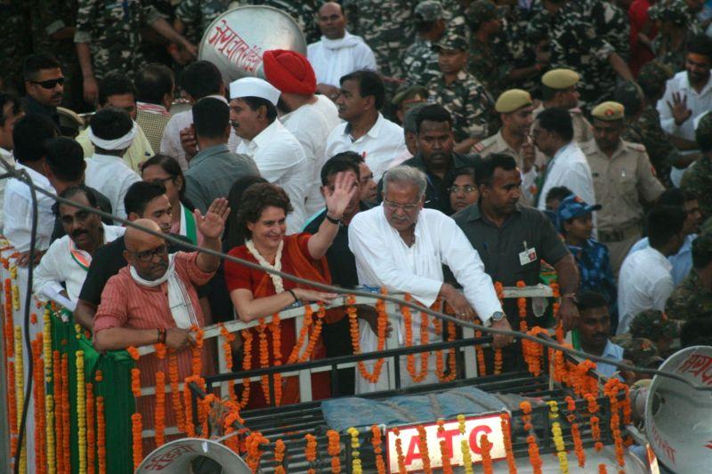 Varanasi: Congress leader Priyanka Gandhi Vadra with Congress' candidate for Varanasi Lok Sabha seat Ajay Rai and Chhattisgarh Chief Minister Bhupesh Baghel during a road show in Varanasi on May 15, 2019. (Photo: IANS)