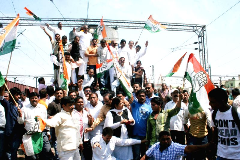 Congress workers participate in `Rail Roko Andolan` at Varanasi railway station on March 12, 2015.