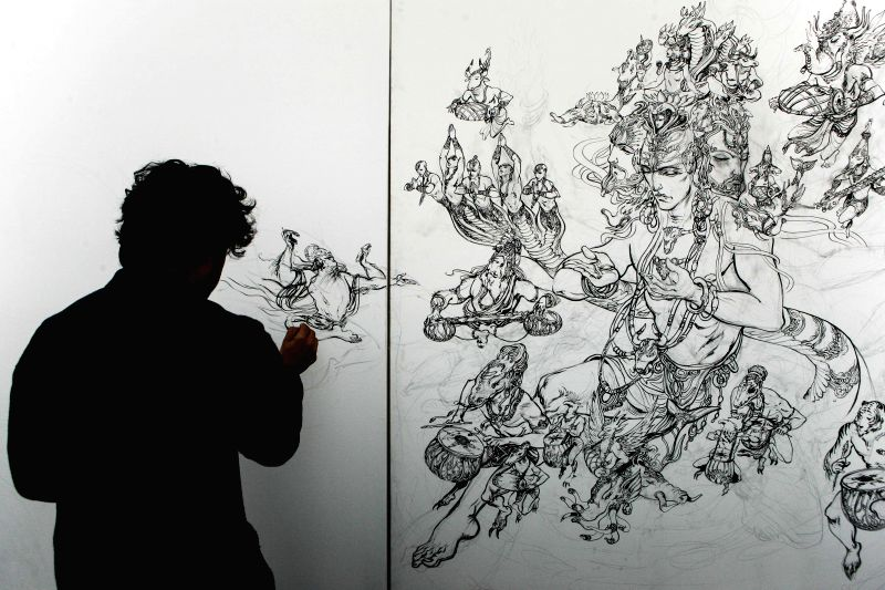 Indian artist Abhishek Singh demonstrates his painting in Varanasi, Uttar Pradesh of India, Dec. 24, 2014. Indian artist Abhishek Singh displayed some of his ... - Abhishek Singh