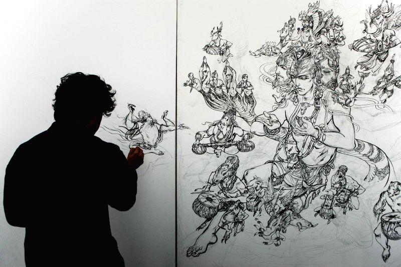 Indian artist Abhishek Singh demonstrates his painting in Varanasi, Uttar Pradesh of India, Dec. 24, 2014. Indian artist Abhishek Singh displayed some of his ... - Abhishek Singh