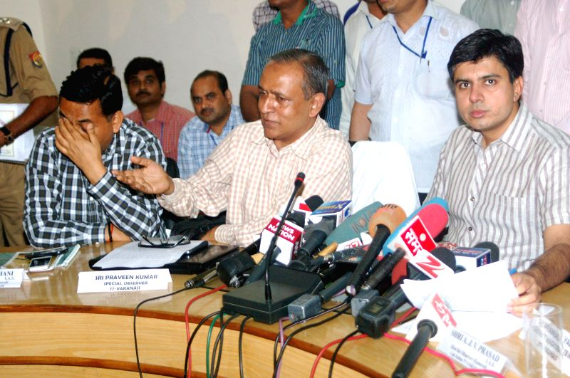 Varanasi DM Pranjal Yadav and others during a press conference in Varanasi on May 11, 2014. - Pranjal Yadav