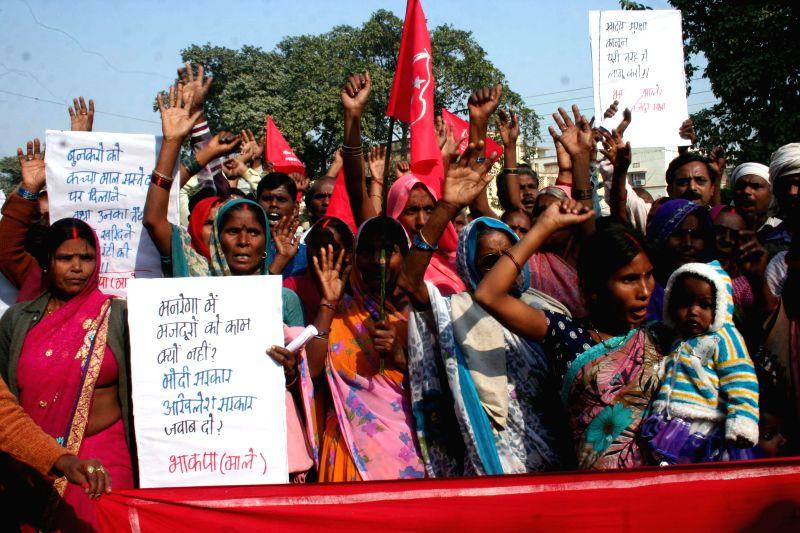 Farmers demonstrate against the central and the Uttar Pradesh Government regarding Mahatma Gandhi National Rural Employment Guarantee Act (MGNREGA) in Varanasi, on Dec 10, 2014.