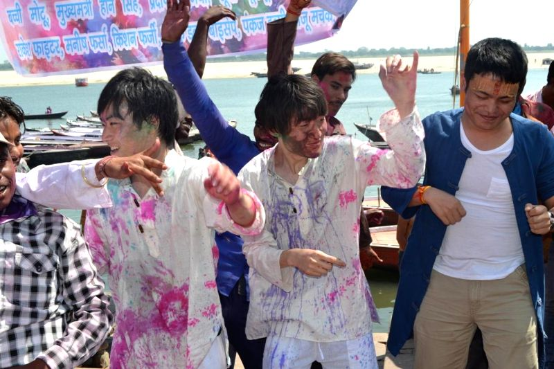 Foreigners celebrate Holi in Varanasi on March 6, 2015.