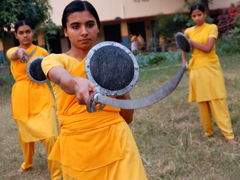 Girls during a sword training session in a Varanasi Gurukul on March 8, 2015. International Women's Day is being celebrated across the world.