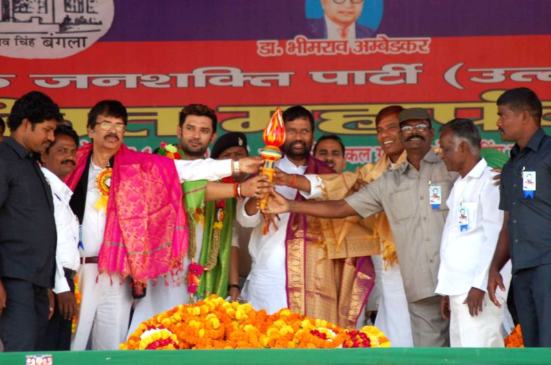 LJP chief and Union Minister for Consumer Affairs, Food and Public Distribution Ramvilas Paswan, party MP Chirag Paswan and others during Dalit Mahapanchayat Rally in Varanasi, on April 6, ...